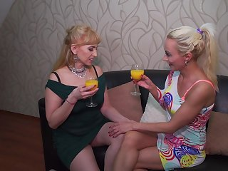 Mature lesbian couple Kasey and Olga C. strip and lick each other