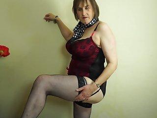 Big-busted mature bungler British granny Allison masturbates in stockings