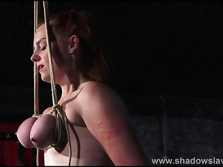 Breast subjugation and tit torture of redhead amateur slave Fiona