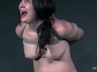 Brunette submissive slut Brie Haven has her pussy fingered in bondage