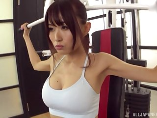 Fit sporty Asian babe pounded doggy style on a yoga ball within reach the gym