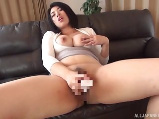 Big-busted Japanese works magic with her toy dicks