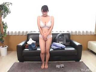 Sweet Asian babe stands unadorned and provides hot casting