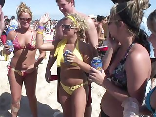 An absent from beach ribbon close to attracting blondes on touching glasses