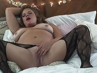 Solo video be advantageous to a BBW wife wide stockings playing with a dildo