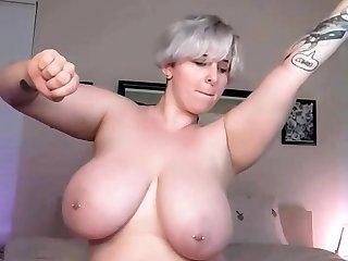 Big-busted hot bosomy festival babe fucks a big dick on webcam