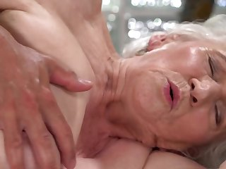 A grotesque old granny is fucked on the side by a dude really hard